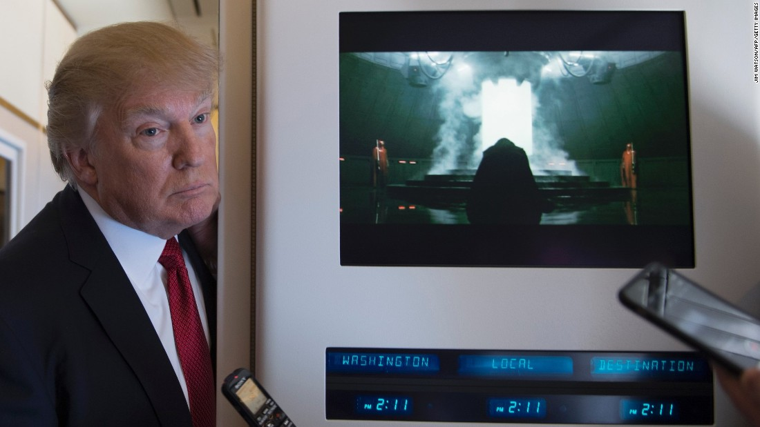 "President Trump speaks to the press aboard Air Force One on Thursday, April 6. The Internet <a href=""http://www.avclub.com/article/trump-stands-next-darth-vader-provoking-brief-mome-253358"" target=""_blank"">had some fun with the juxtaposition</a> of Trump and ""Star Wars"" villain Darth Vader, who appeared in the scene on the right from the film ""Rogue One."""