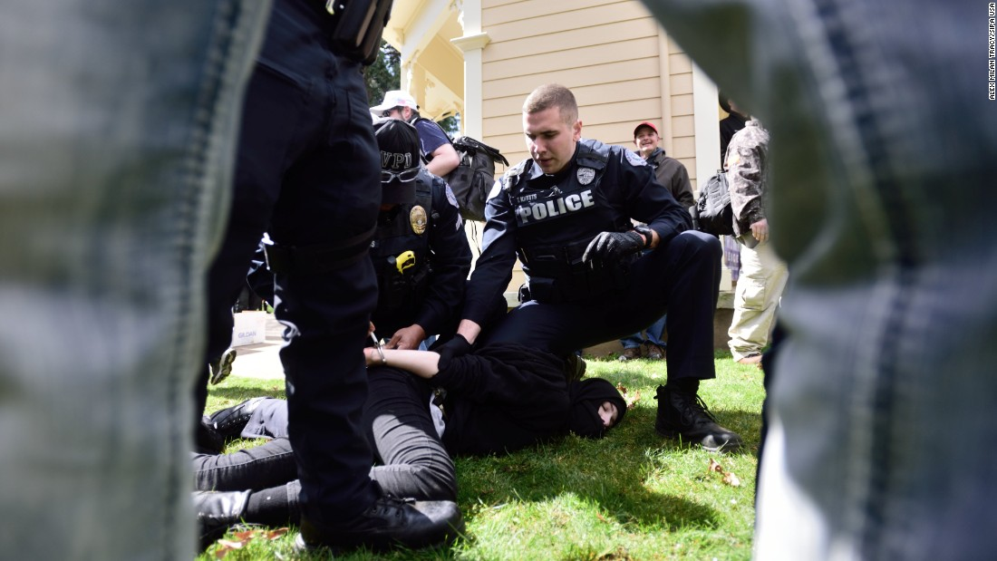 Police arrest someone after clashes broke out between Trump supporters and Trump protesters at a pro-Trump rally in Vancouver, Washington, on Sunday, April 2.