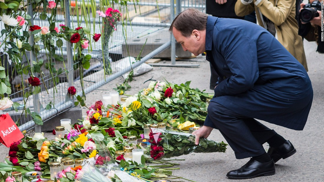 Swedish Prime Minister Stefan Lofven visits the scene of a suspected terror attack on Saturday, April 8. A day earlier, a truck crashed in front of a Stockholm department store, killing four people and injuring more than a dozen others.