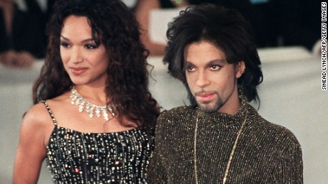 "LONDON, UNITED KINGDOM - JUNE 10:  Prince poses for photographers with his wife Mayte as they arrives at the De Beer and Versace ""Diamonds are forever"" charity fashion event 09 June 1999. A host of international celebrities turned out for the event which will raise funds for three charities including the Prince's Foundation for architecture and the environment.  (Photo credit should read SINEAD LYNCH/AFP/Getty Images)"
