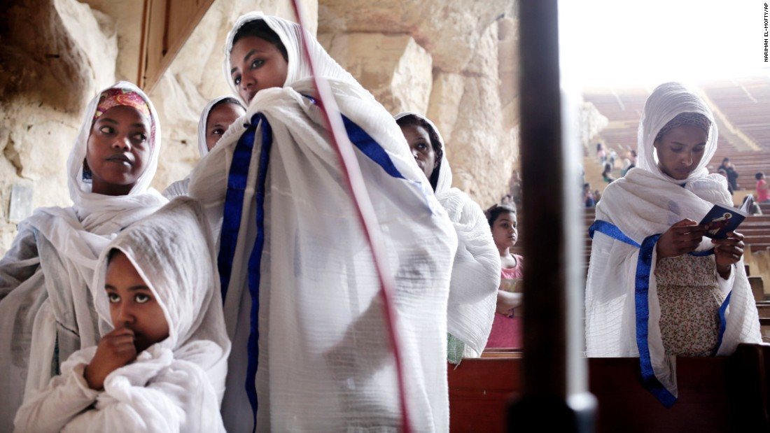 Ethiopians pray during a Palm Sunday Mass inside the St. Samaan Church overlooking Cairo.