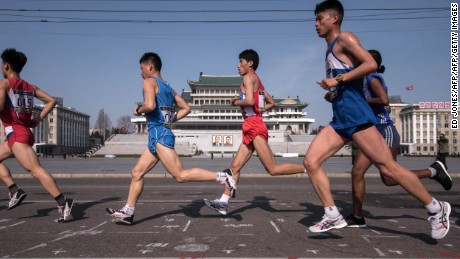 Competitors run through Kim Il-Sung square during the Pyongyang Marathon in Pyongyang on April 9, 2017.  Hundreds of foreigners lined up in Pyongyang's Kim Il-Sung Stadium on April 9 for the city's annual marathon, the highlight of the tourism calendar in isolated North Korea. / AFP PHOTO / Ed JONES        (Photo credit should read ED JONES/AFP/Getty Images)