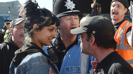 An English Defence League member, right, and a woman identified Saffiyah Khan, are pictured during an EFL rally in Birmingham, England, on Saturday.