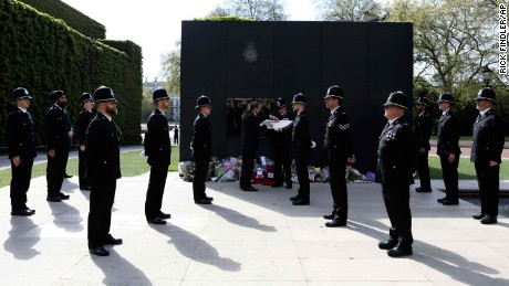 Police attend a ceremony where Palmer's name was added to the National Police Memorial's Roll of Honour and Remembrance.