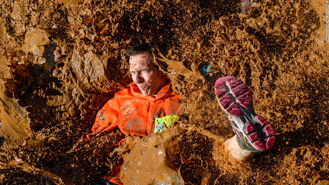 A competitor lands in mud Saturday, April 8, during the Barjot Run obstacle race in Biere, Switzerland.