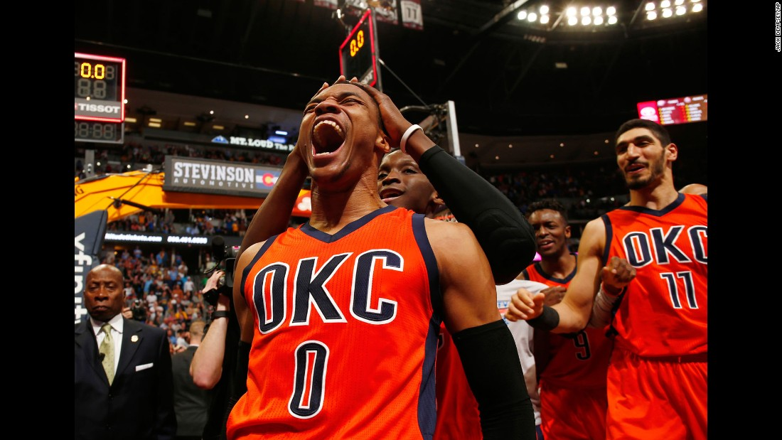 Oklahoma City guard Russell Westbrook (No. 0) celebrates after hitting a buzzer-beating 3-pointer to win at Denver on Sunday, April 9. Westbrook finished with his 42nd triple-double of the season -- an NBA record.