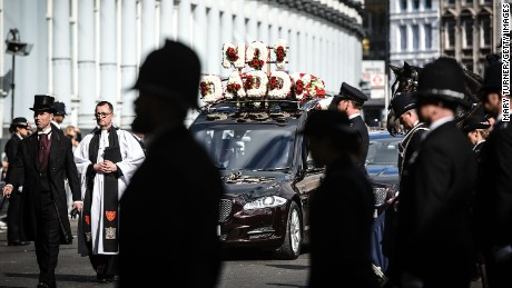 Police line the streets as the funeral cortege of PC Keith Palmer leaves Southwark Cathedral following his funeral service on Monday, April 10 in London.