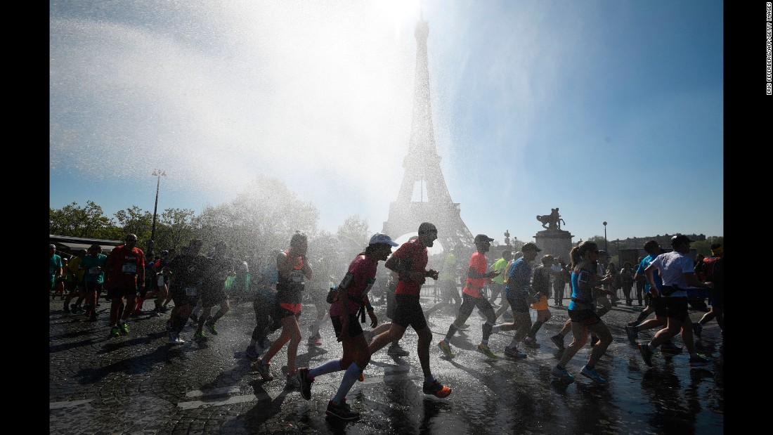 "Runners go through a cooling water stream as they compete in the Paris Marathon on Sunday, April 9. <a href=""http://www.cnn.com/2017/04/04/sport/gallery/what-a-shot-sports-0404/index.html"" target=""_blank"">See 33 amazing sports photos from last week</a>"