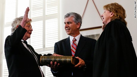 Kay Ivey, left, takes the oath of office to be governor of Alabama as she is sworn in by acting Chief Justice Lyn Stuart on April 10, 2017, in Montgomery, Alabama.