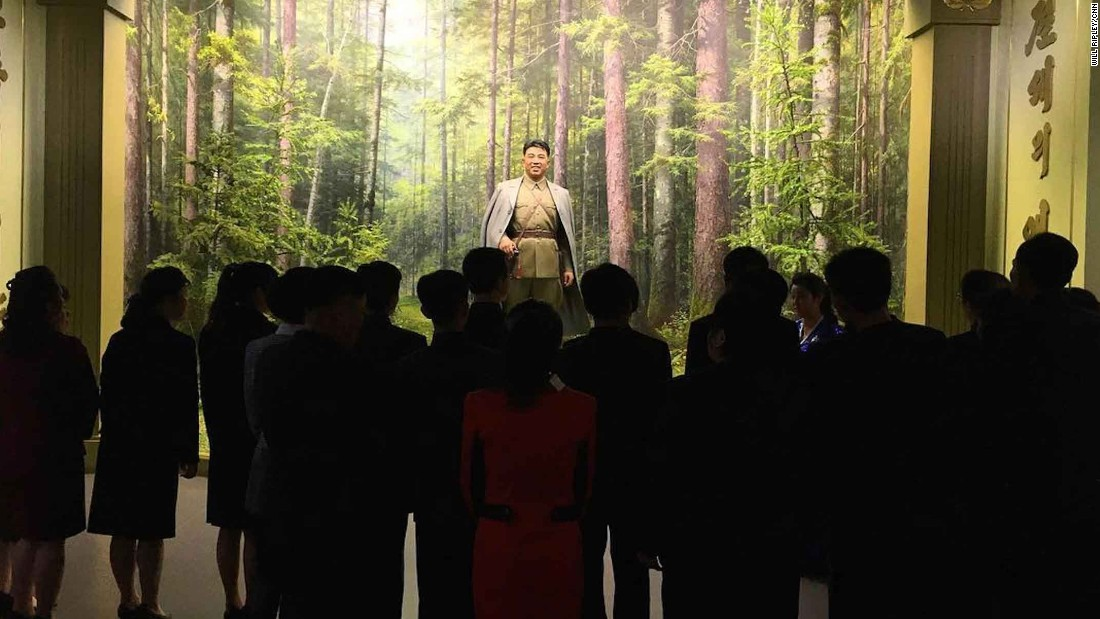 North Koreans observe a statue of their founder, Kim Il Sung, at the Museum of the Korean Revolution on April 10. CNN's Will Ripley said it was the first time CNN cameras had been allowed into the Pyongyang museum.