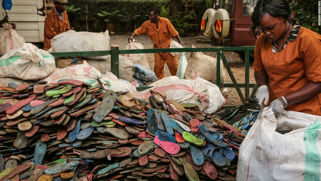 """Over three billion people can only afford that type of shoe,"" says Erin Smith of Ocean Sole, a Kenyan conservation group and recycling collective, above pictured as they collect flip flops."