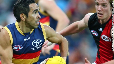 Eddie Betts runs with the ball during a match between the Adelaide Crows and the Essendon Bombers