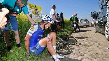 Netherlands' Niki Terpstra sits after falling during the 115th edition of the Paris-Roubaix one-day classic.
