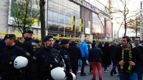 Police patrol outside the stadium after the team bus of Borussia Dortmund had some windows broken by an explosion some 10km away from the stadium prior to the UEFA Champions League 1st leg quarter-final football match BVB Borussia Dortmund v Monaco in Dortmund, western Germany on April 11, 2017.