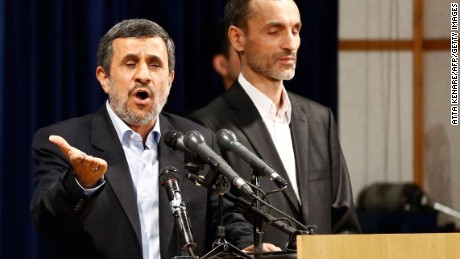 Ahmadinejad (left) speaks,  accompanied by former Iranian Vice President Hamid Baghaei, after registering at the Interior Ministry's election headquarters.