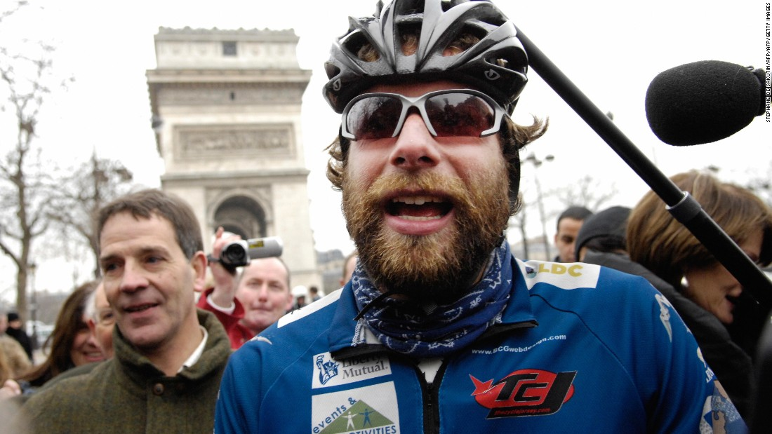 "Beaumont -- pictured surrounded by fans as he arrived on February 15, 2008 at the finish line of his world tour at the Place de l'Etoile in Paris -- said his record-breaking solo effort was ""wild man riding."""