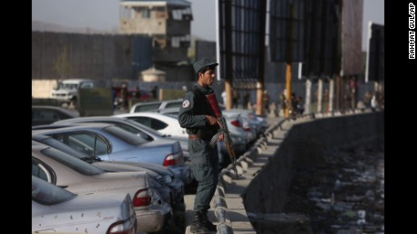Security forces stand by Wednesday after a suicide blast near government offices in the Afghan capital.