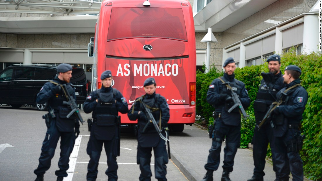 Policemen stood guard in front of a Monaco team bus Wednesday before the rescheduled Champions League encounter as security was tightened. <br />