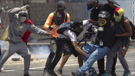 Violence at parade highlights escalating Venezuela protests