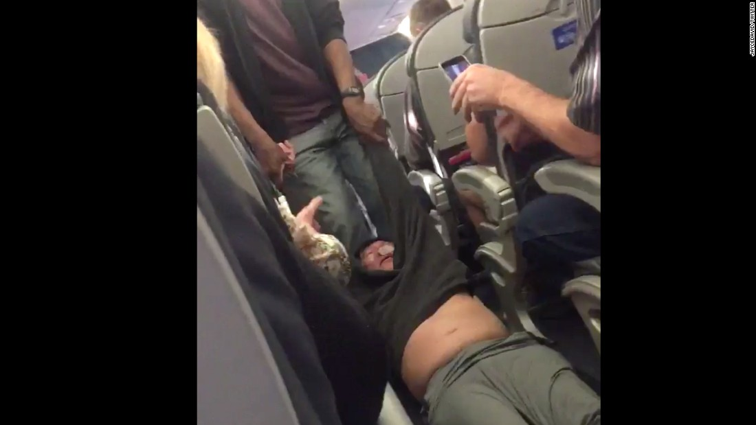 United passenger David Dao swung fists violently, officers' reports say