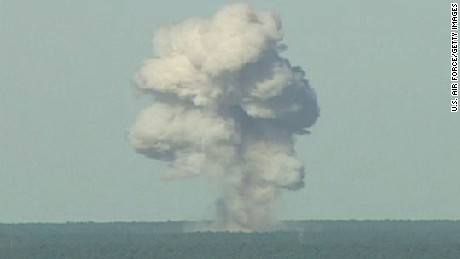 In this U.S. Air Force handout,  a GBU-43/B bomb, or Massive Ordnance Air Blast (MOAB) bomb, explodes November 21, 2003 at Eglin Air Force Base, Florida. MOAB is a 21,700-pound that was droped from a plane at 20, 000 feet.