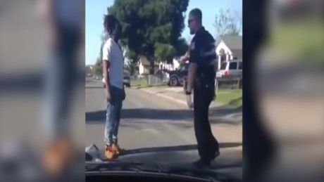 A cellphone video shows Cain and the officer arguing.