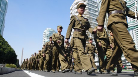 Soldiers march during the opening of Ryomyong Street.