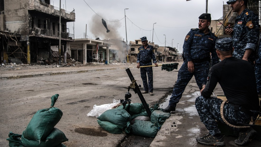 "Iraqi federal police fire a mortar at an ISIS position in Mosul, Iraq, on Wednesday, April 12. Iraqi forces <a href=""http://www.cnn.com/interactive/2017/03/world/mosul-iraq-cnnphotos/index.html"" target=""_blank"">have been fighting ISIS militants</a> for control of the city."