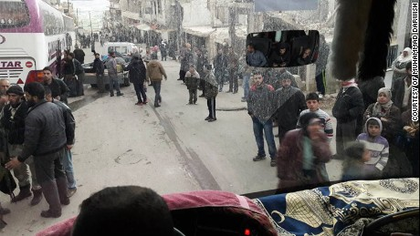 A photo taken by Muhammad Darwish from a bus as it leaves Madaya on April 14.