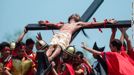 A Philippine Christian devotee reacts in pain while nailed to a cross during a reenactment of the Crucifixion of Christ during Good Friday celebrations ahead of Easter in the village of Cutud near San Fernando, north of Manila on April 14, 2017. Devotees in the fervently Catholic Philippines nailed themselves to crosses and whipped their backs in extreme acts of faith that have become an annual tourist attraction. / AFP PHOTO / NOEL CELIS        (Photo credit should read NOEL CELIS/AFP/Getty Images)