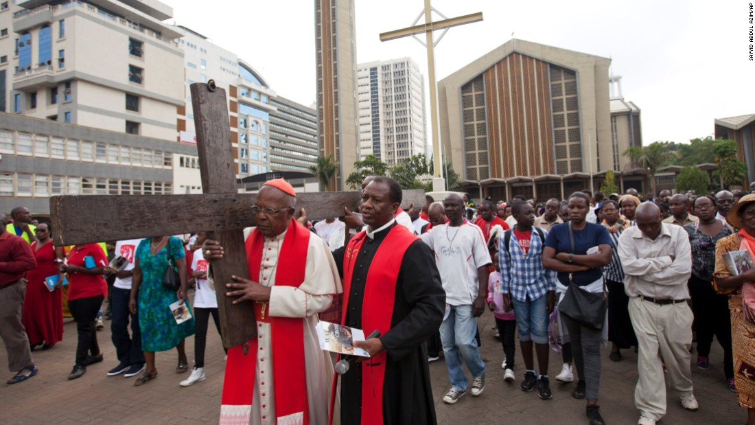 Cardinal John Njue, head of the Catholic Church in Kenya, carries a cross through the streets of Nairobi on April 14.