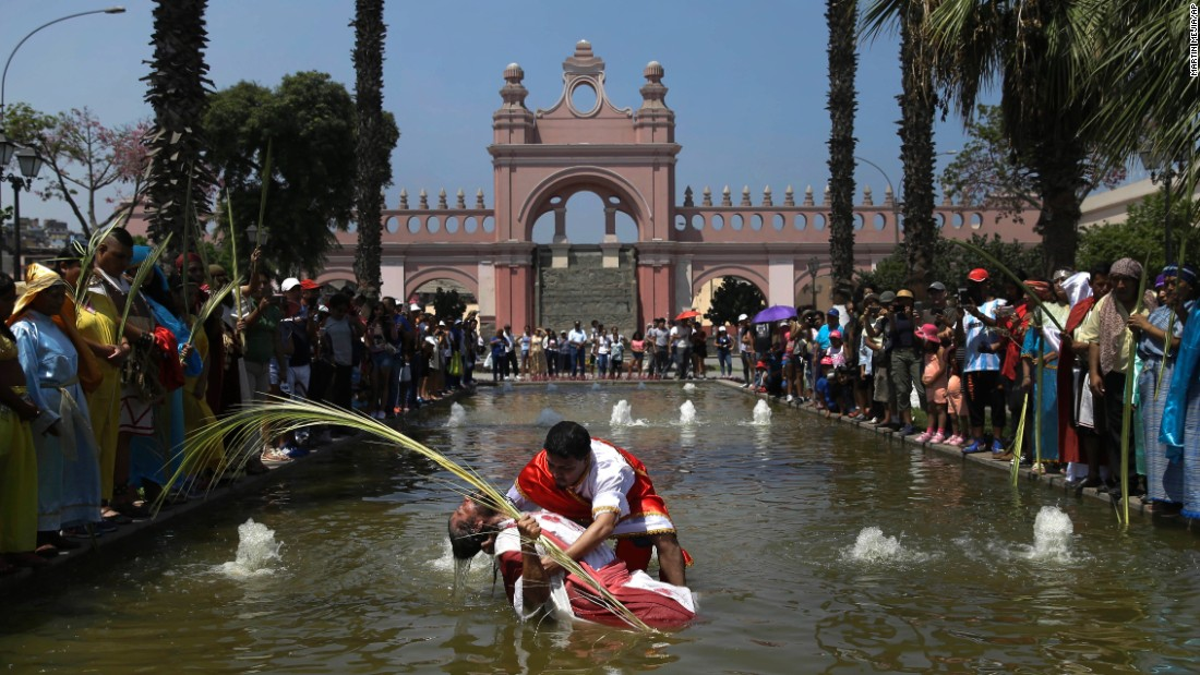 People re-enact the baptism of Jesus during Holy Week celebrations in Lima, Peru, on April 13.