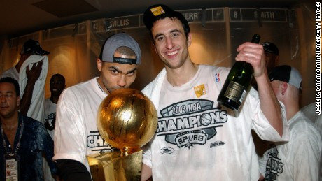 SAN ANTONIO - JUNE 15: Tony Parker #9 (L) and Emanuel Ginobili #20 of the San Antonio Spurs pose with the NBA Championship trophy after Game six of the 2003 NBA Finals against New Jersey Nets at SBC Center on June 15, 2003 in San Antonio, Texas. The Spurs won 88-77 and defeated the Nets to win the NBA Championship. NOTE TO USER: User expressly acknowledges and agrees that, by downloading and/or using this Photograph, User is consenting to the terms and conditions of the Getty Images License Agreement Mandatory Copyright Notice: Copyright 2003 NBAE (Photo by Jesse D. Garrabrant/NBAE via Getty Images)