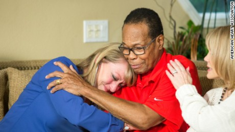 Mary Reuland listens to her late son's heart in the chest of Rod Carew.