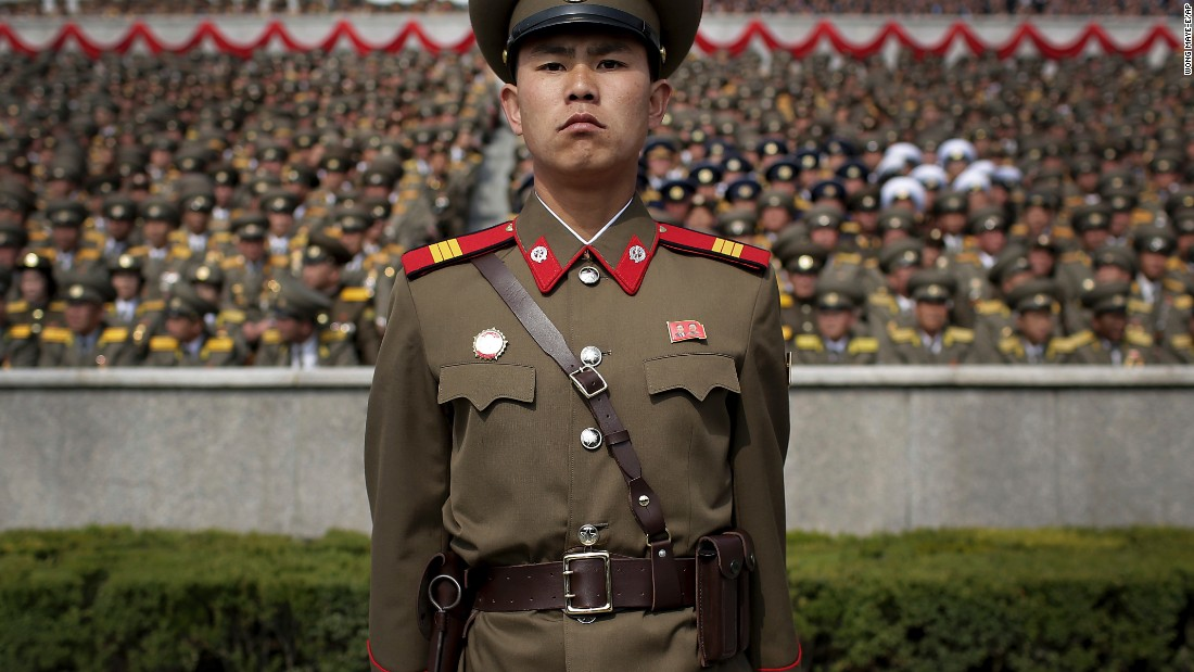 A soldier stands guard at the Kim Il Sung Square.