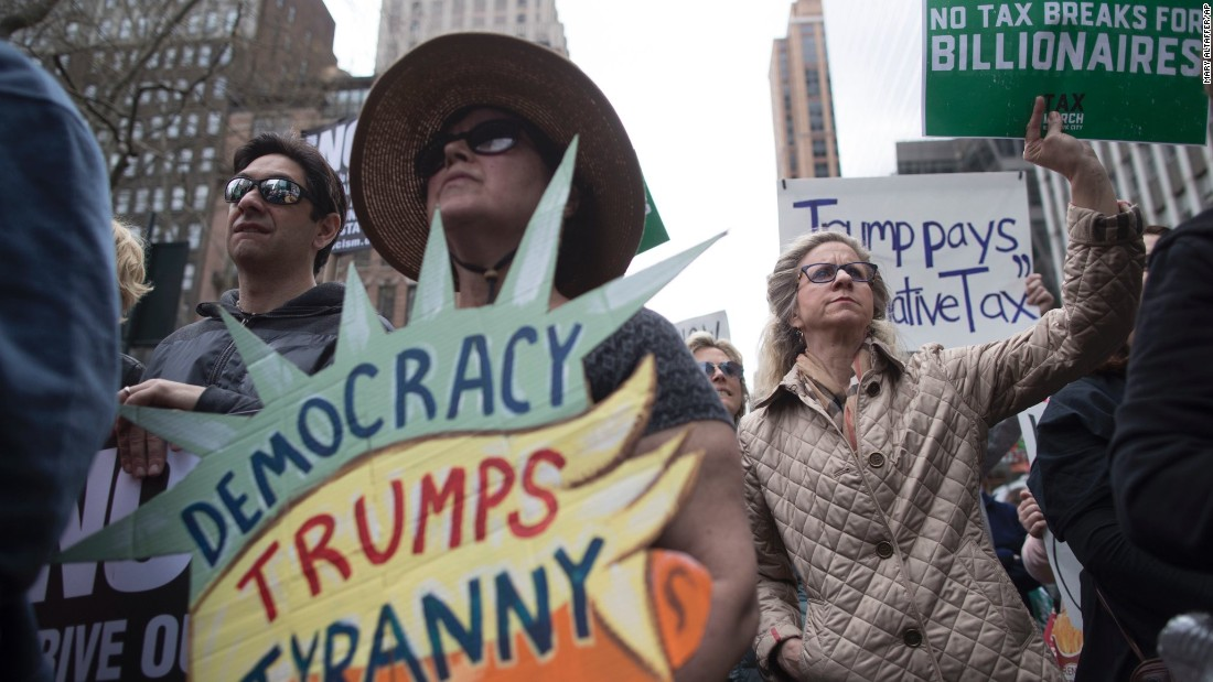 "Demonstrators participate in a march and rally Saturday, April 15, in New York demanding <a href=""http://money.cnn.com/2017/04/15/news/economy/trump-tax-return-protest-march/index.html"" target=""_blank"">President Donald Trump release his tax returns</a>, saying Americans deserve to know about his business ties and potential conflicts of interest. Similar protests took place in dozens of cities nationwide."