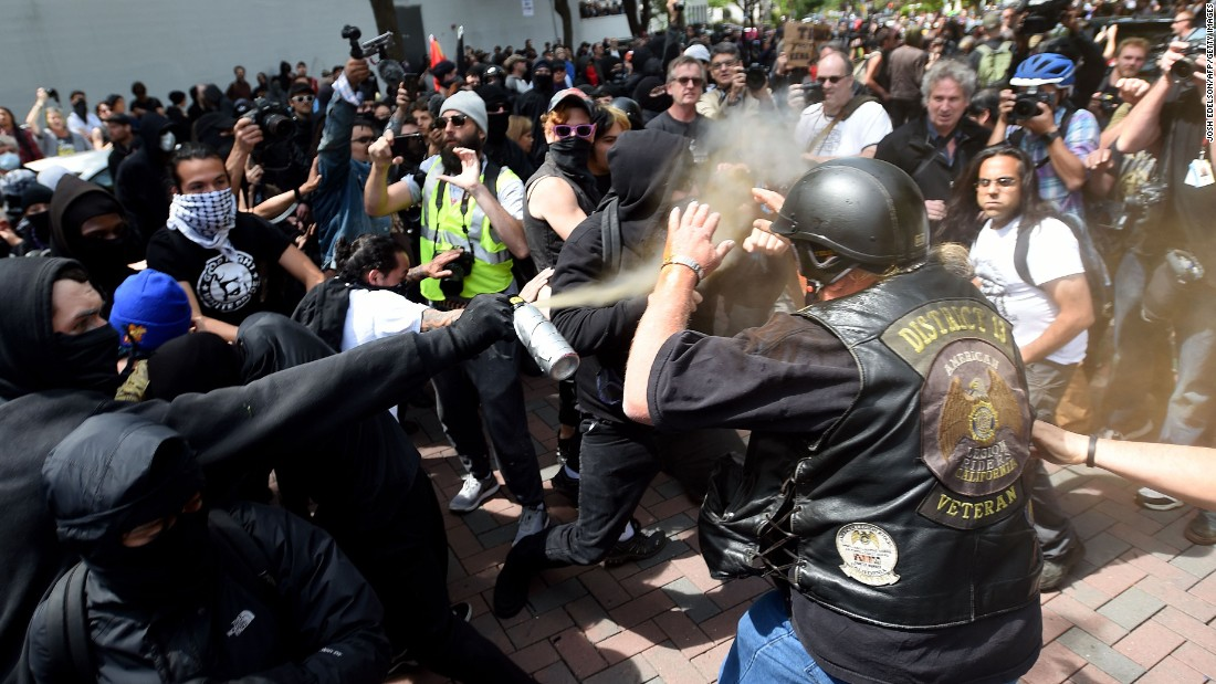 "A man is sprayed with a chemical irritant as multiple fights break out between <a href=""http://www.cnn.com/2017/04/15/us/berkeley-protests-trump/index.html"" target=""_blank"">Trump supporters and protesters in Berkeley</a>, California."