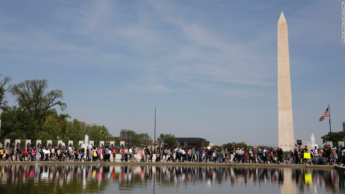 Tax Day demonstrators march to the Lincoln Memorial in Washington.