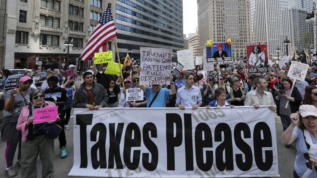 Demonstrators participate in the march and rally in Chicago.