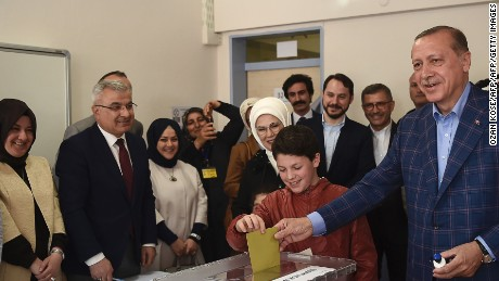 Turkish President Recep Tayyip Erdogan casts his vote accompanied by his wife Emine Erdogan at a polling station in the Uskudar district of Istanbul.