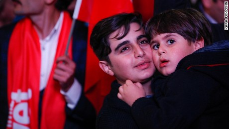 "Turkish youths celebrate in Ankara moments after preliminary results showed a ""Yes"" win."