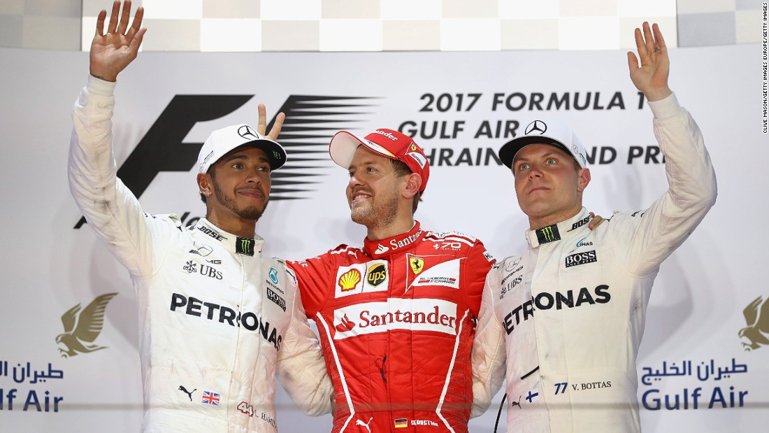 Vettel on the podium with second-placed Lewis Hamilton (left) and Valtteri Bottas who came home third.