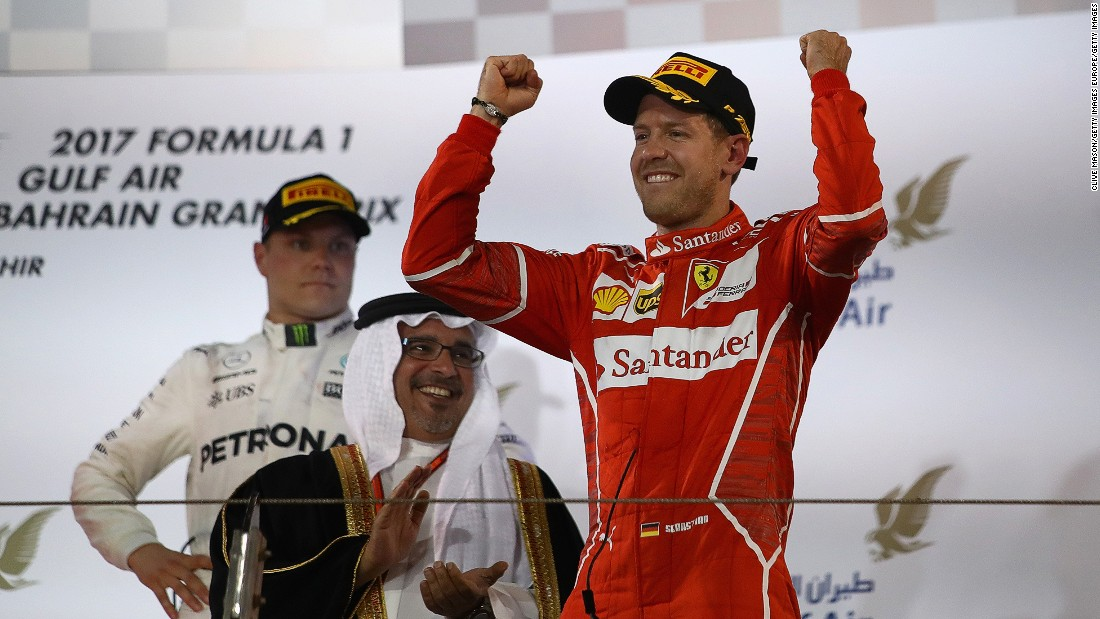 Sebastian Vettel salutes the crowd in Bahrain after clinching his second win of the 2017 F1 season.