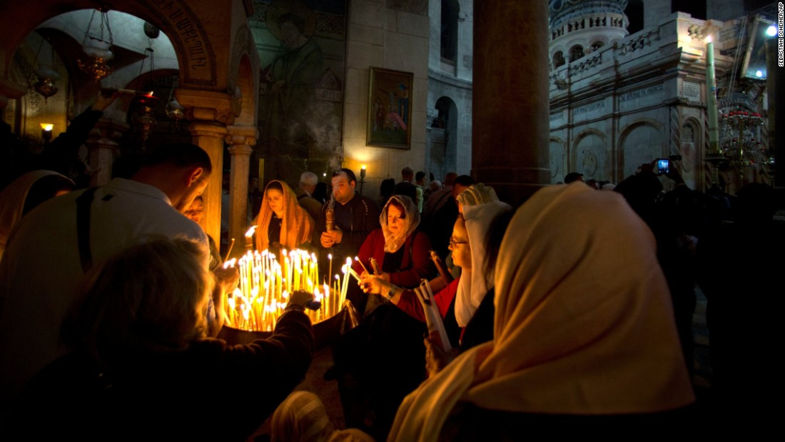 Christian pilgrims in Jerusalem light candles April 16 during the Easter Sunday procession at the Church of the Holy Sepulchre, traditionally believed by many Christians to be the site of the crucifixion and burial of Jesus.