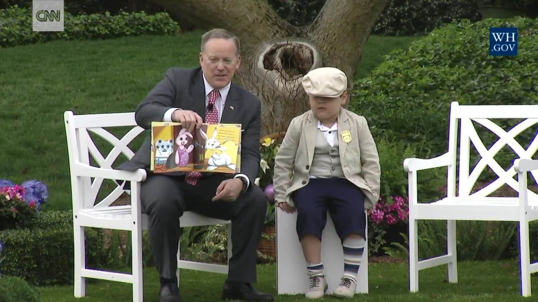 Spicer reads to kids at the Easter Egg Roll