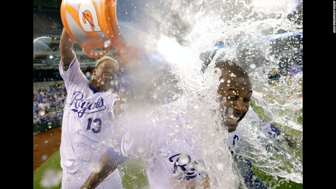 Salvador Perez of Kansas City dumps a bucket of water over teammate and MVP Lorenzo Cain after their team defeated Oakland 3-1 in Kansas City on Thursday, April 13.