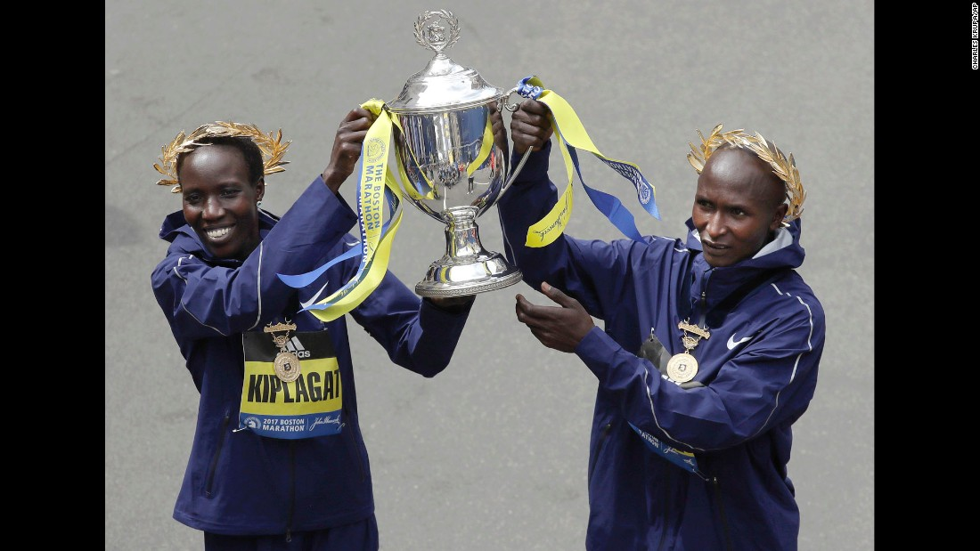 Kenya's Edna Kiplagat, left, and Geoffrey Kirui hold a trophy after their victories in the Boston Marathon on Monday, April 17. Kiplagat finished in 2:21:52 and Kirui finished in 2:09:37, winning the women's and men's races, respectively.