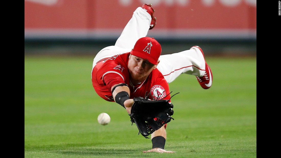 Los Angeles right fielder Kole Calhoun dives but misses a single by Texas' Jonathan Lucroy during a game in Anaheim, California, on Wednesday, April 12. Texas won 8-3.
