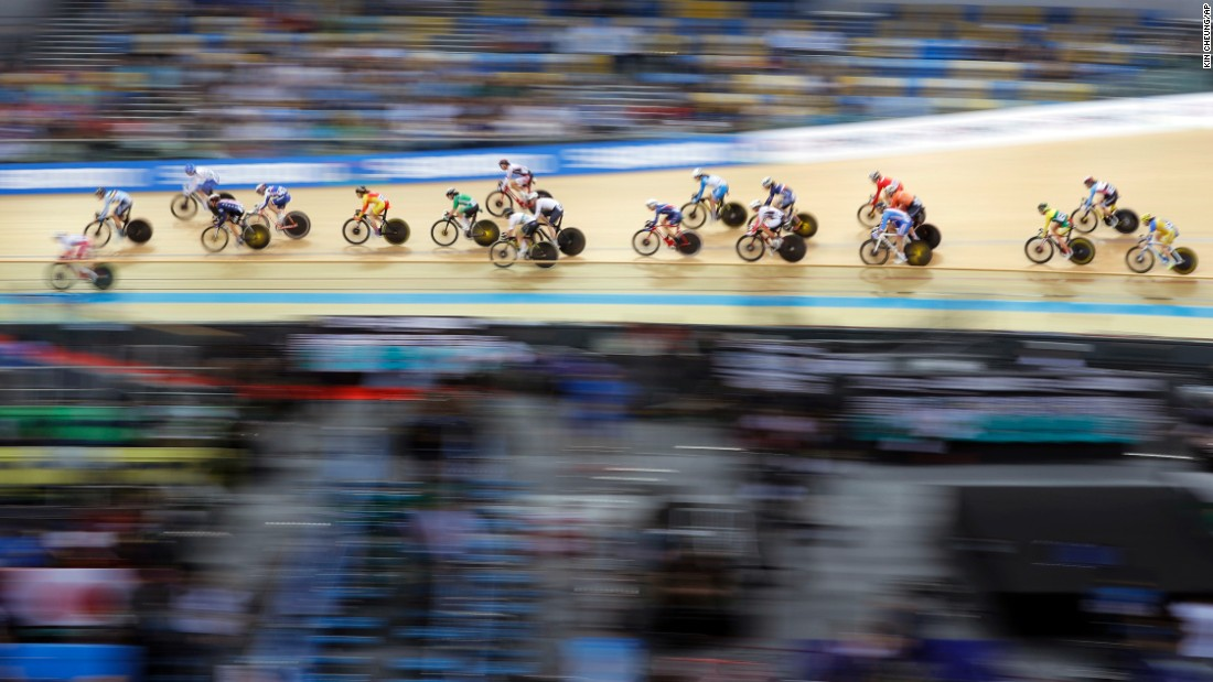 This panning shot shows track cyclists as they compete in the women's scratch race at the Track Cycling World Championships in Hong Kong on Wednesday, April 12.