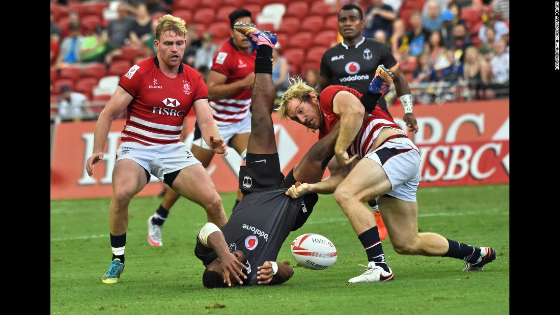 Toby Fenn of Hong Kong tackles Fiji's Amenoni Nasilasila during Day One of the Singapore Rugby Sevens tournament on Saturday, April 15.